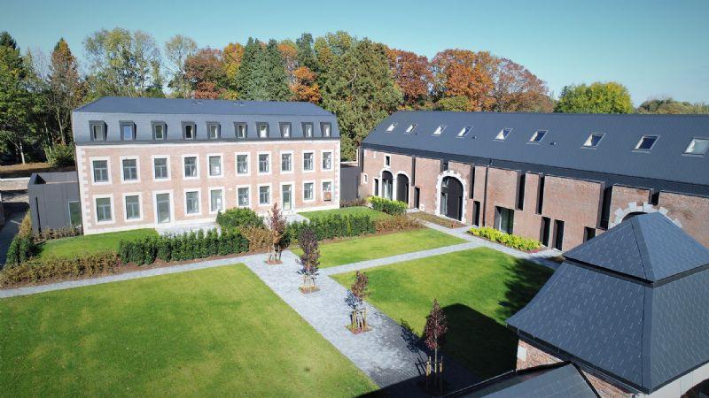Rénovation-transformation de la ferme-château d'Angoxhe en unités de logement