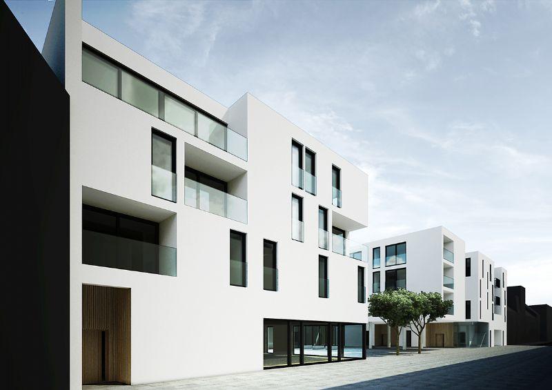 De witte façade wordt geaccentueerd met diepe uitsnijdingen