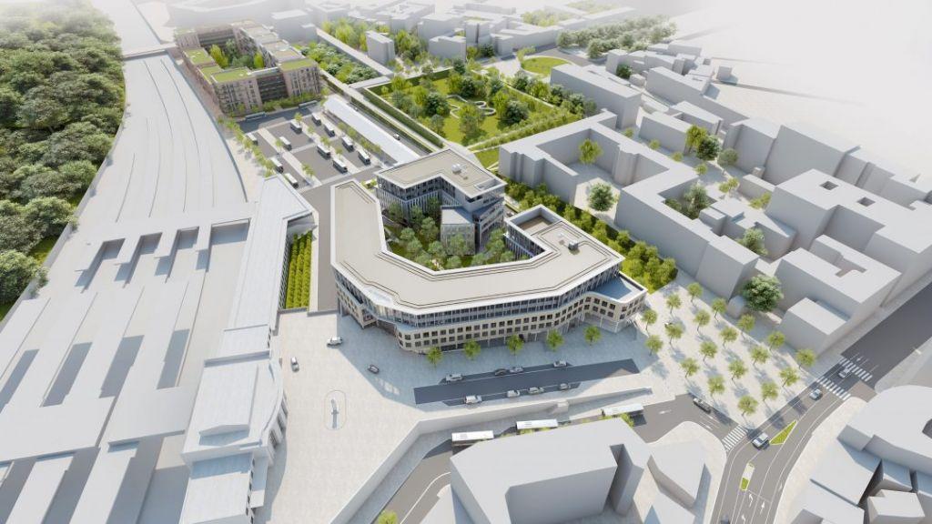 A gauche, la gare ferroviaire. Au centre, la gare routière et les immeubles de bureaux et commerces. A droite, les immeubles de logement et le jardin.