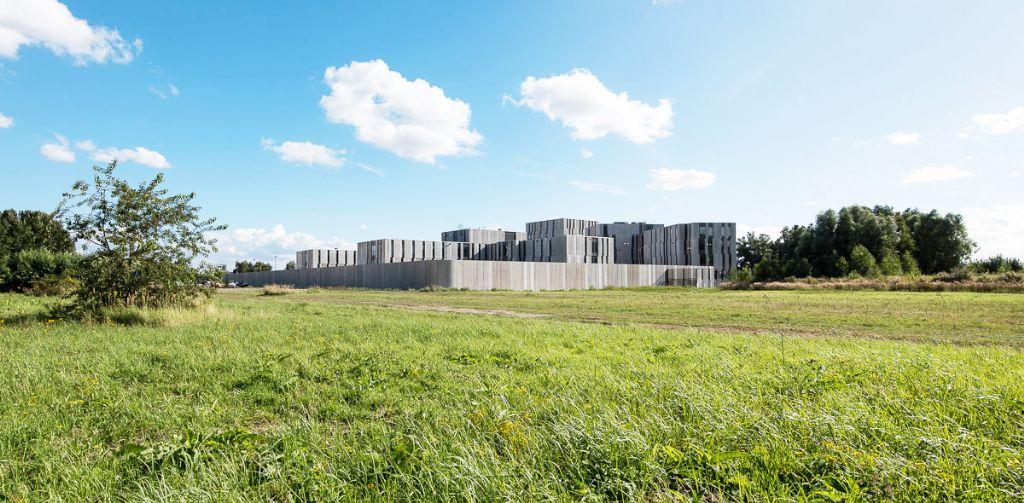 VK Architects & Engineers en opdrachtgever Regie der Gebouwen streefden naar een maximale integratie in het landschap, met een goed evenwicht tussen natuur en bebouwing. (Beeld: VK Architects & Engineers)