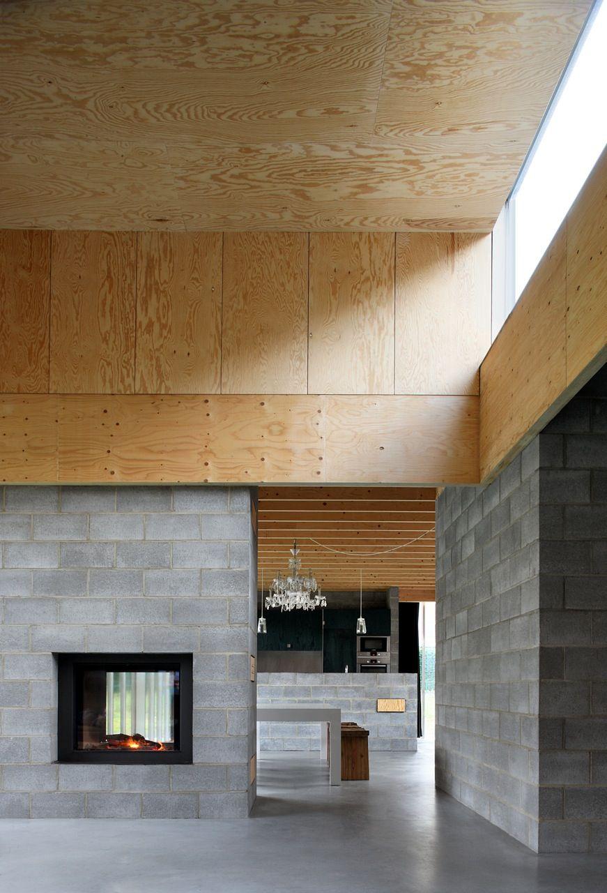 De zitruimte met hogere plafondhoogte als dominante ruimte in het plan