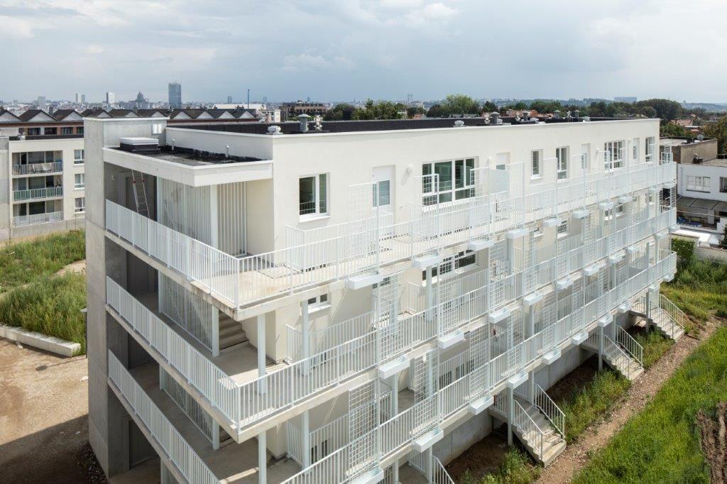 Zes nieuwbouwblokken met verschillende groottes bieden samen plaats aan 134 sociale appartementen.