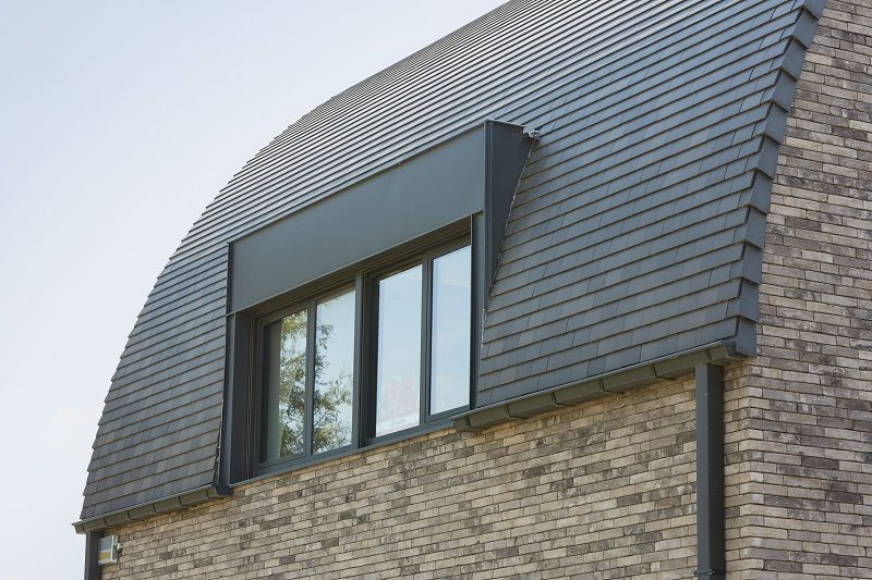 Matériaux utilisés : Terca Iluzo Pagus gris-noir + Koramic Tuile plate 301 bleu fumé Architecte : Arch. M. Malfait, Ledegem