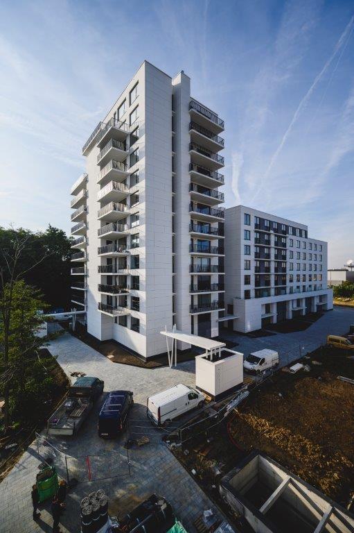 B House: witte torengebouwen met gepersonaliseerde appartementen in Evere en Schaarbeek.