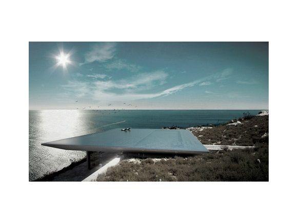 Het dak vormt een optische illusie in samenwerking met de zee.