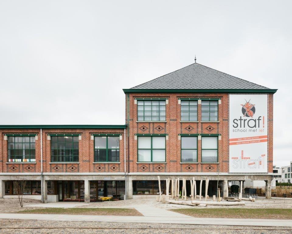 Oud mijngebouw omgetoverd tot kleuter- en basisschool door a2o-architecten