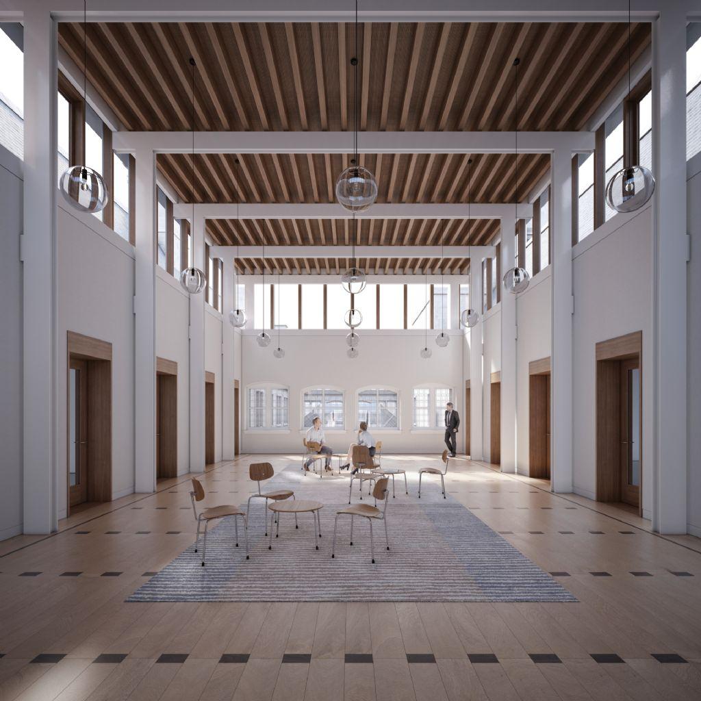 Op de tweede verdieping - het Verlicht Verdiep - worden twee centrale vestibules gerealiseerd. Deze zorgen voor een overvloedige daglichtinval en een scheerzicht op de historische daken en campanile.