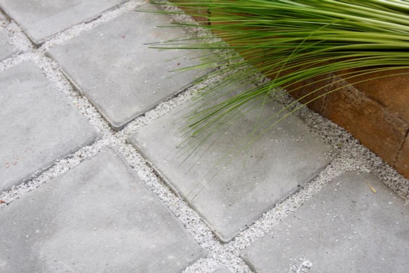 Waterdoorlatende betonstraattegels van Coeck
