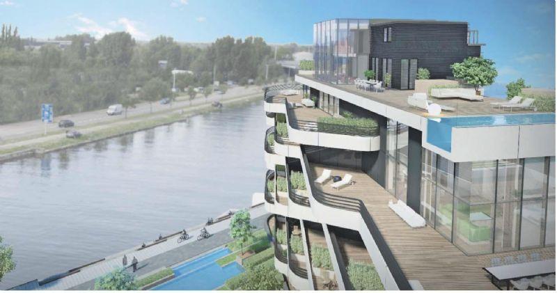 De architectuur is open, licht en staat in relatie met het water.