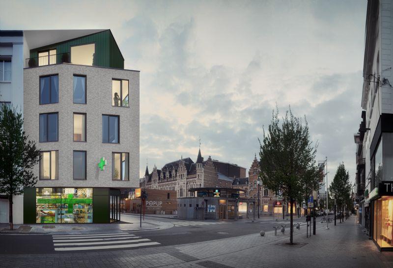 De groene elementen vormen de link met het vorige gebouw.