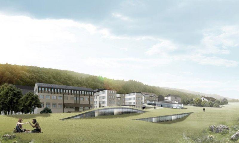 Het gebouw gaat op in het landschap.