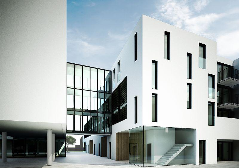 Een glazen loopbrug verbindt de twee gebouwen met elkaar