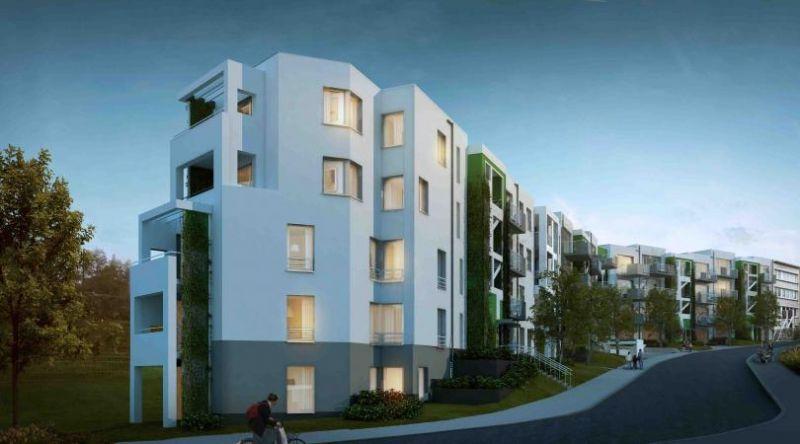 Het sociaal huisvestingscomplex voor het Brusselse Woningfonds wordt gerealiseerd op een vrij smal, hellend terrein langs een spoorweg.