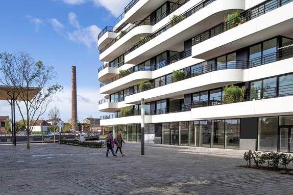 De eerste fase voorziet in zestig wooneenheden en enkele commerciële ruimtes.