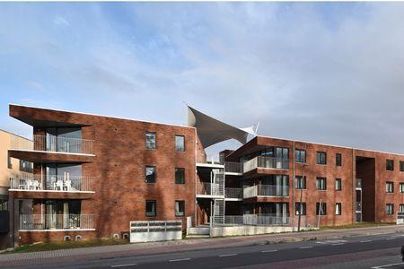 Donkerrode baksteen geeft cachet aan sociale woningen