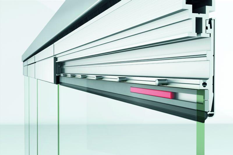 Een indicatorsysteem geeft met kleurcodes de status van het bovenste slot op een draai-/schuifpaneel weer.