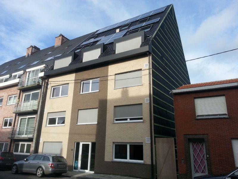 Het Evolutionproject in Maldegem: een appartementsgebouw met een BEO-veld en betonkernactivering.