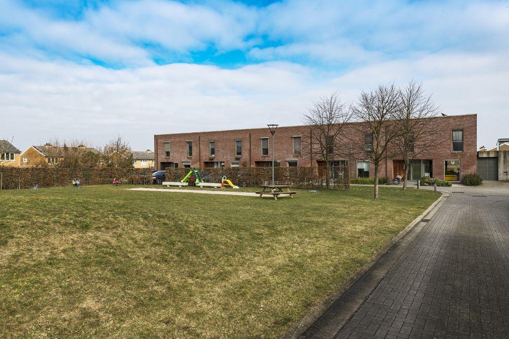 Woonwijk rond uitgestrekte collectieve tuin ontsluit binnengebied in Aalst