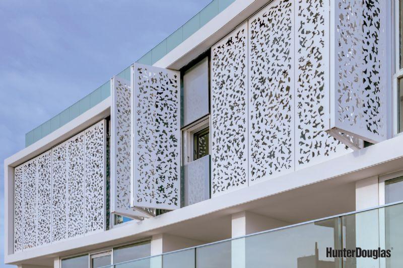 Een façade die zich tot een open schil ontvouwt