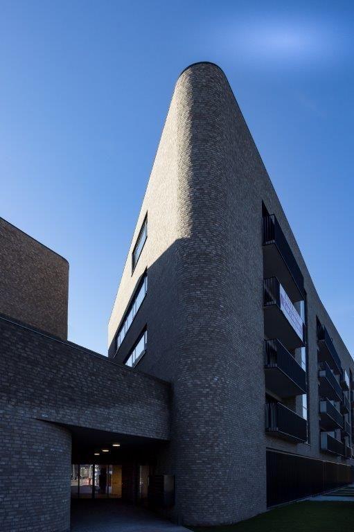 De architecten integreerden rondingen in de kop van de gebouwen om de aanblik van het geheel minder scherp te maken. (Beeld: Ph.Hannon)