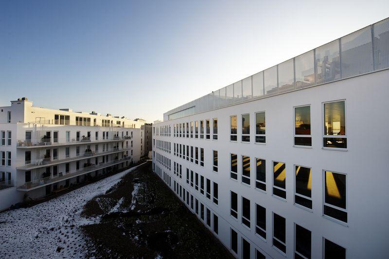 Wit architectonisch beton Nieuw Zuid verwijst naar Antwerpen van 19de eeuw
