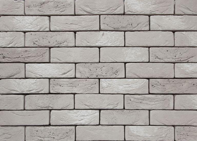 Nieuw in het gamma: Rega, een lichte metaalgrijze baksteen met witte en grijze nuances.