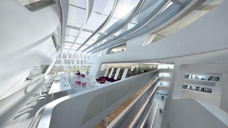 Binnenin worden de rechte hoeken curvilineair en vloeiend om licht binnen te laten en uitzichten en verbindingen binnen het gebouw mogelijk te maken.