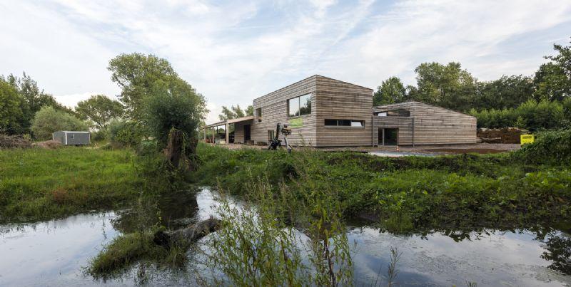 Denc! en Eco-Architecten ontwerpen ecologische loods voor Natuurpunt in Gent