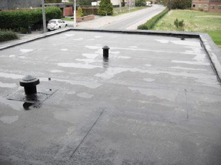 Waterstagnaties op platte daken